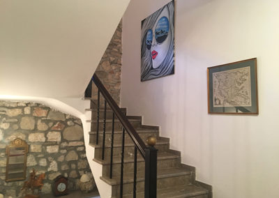 Stairs to 2. floor and wild horses painting